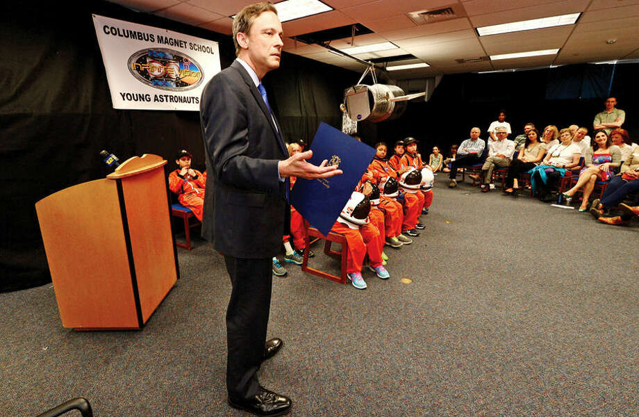 Hour photo / Erik Trautmann State Represenative Fred Wilms reflects on the program his son participated in as the Young Astronauts program at Columbus Magnet School celebrates the landing of their latest mission, Infinite Vision, and the programs 20th anniversay Friday morning at the school.