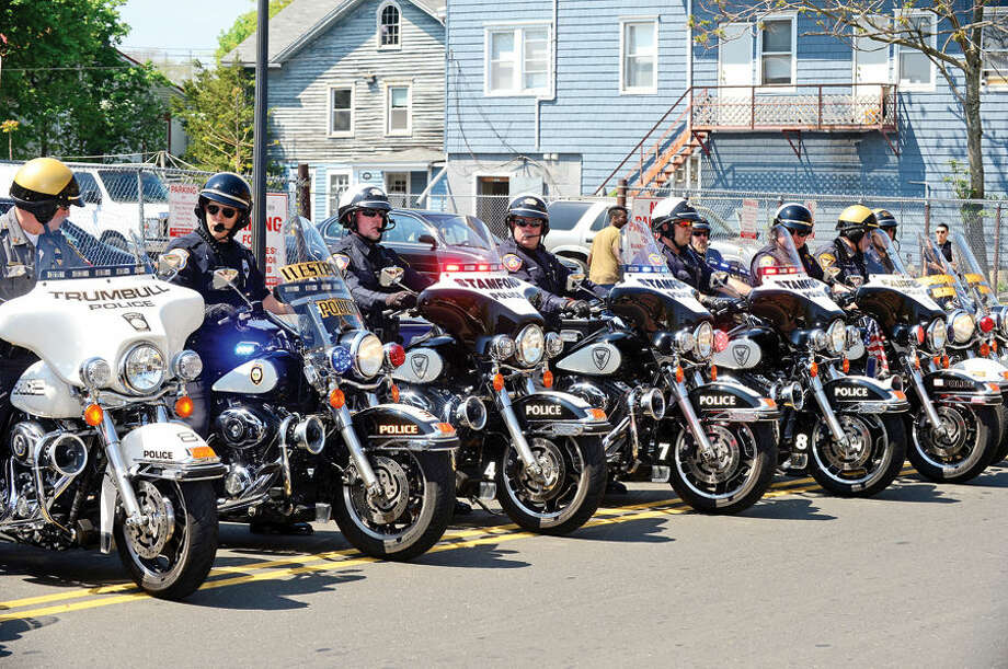 Hour photo / Erik Trautmann Motorcycle police from Fairfield County arrive at the annual Norwalk Police Department Police Memorial Service Friday at police headquarters.