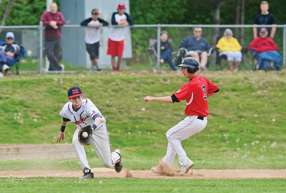 Hour photo / Erik Trautmann Brien McMahon High School's Chris Giordano gets a late throw at third during their baseball game against Fairfield Warde Saturday in Norwalk.