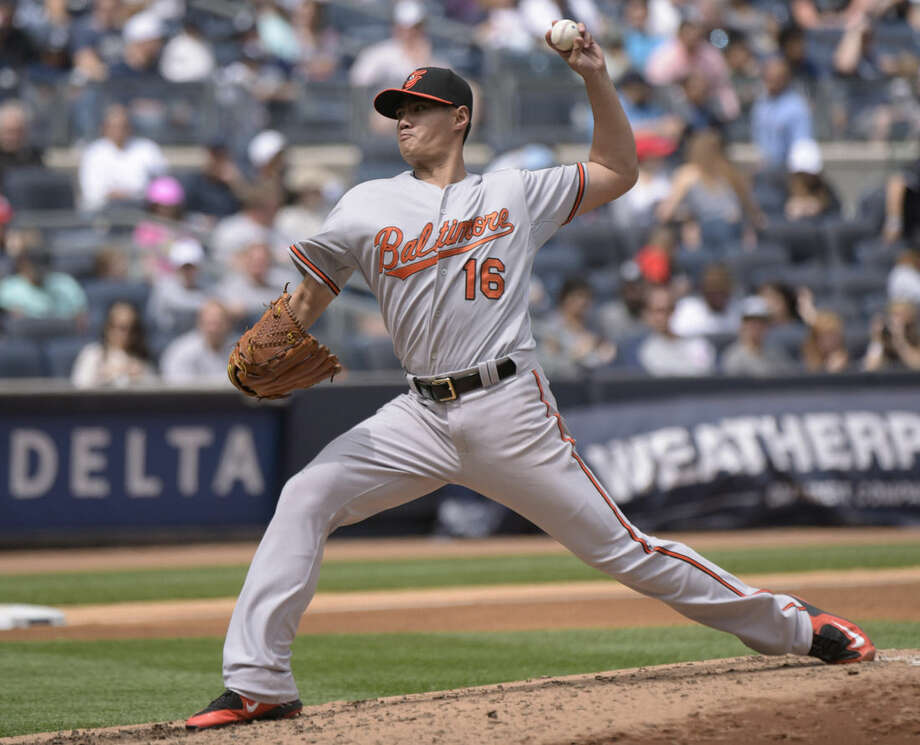 Baltimore Orioles pitcher Wei-Yin Chen delivers the ball to the New York Yankees during the fourth inning of a baseball game Saturday, May 9, 2015, at Yankee Stadium in New York. (AP Photo/Bill Kostroun)