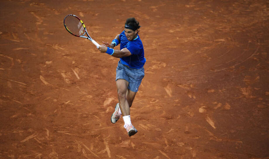 Rafael Nadal of Spain in action against Ivan Dodig from Croatia, during the Barcelona open tennis in Barcelona, Spain, Thursday, April 24, 2014. (AP Photo/Manu Fernandez)