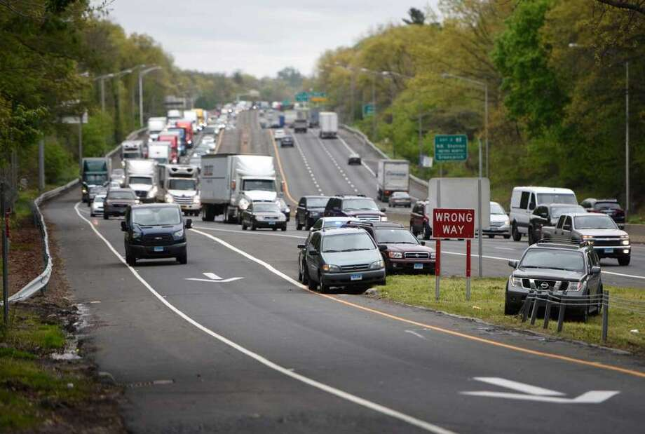 Traffic is backed up for miles as Exit 2 on I-95 is reopened after a high-speed pursuit starting in Bridgeport ended on the highway exit ramp in the Byram section of Greenwich, Conn. Wednesday, May 4, 2016. (Photo: Tyler Sizemore)