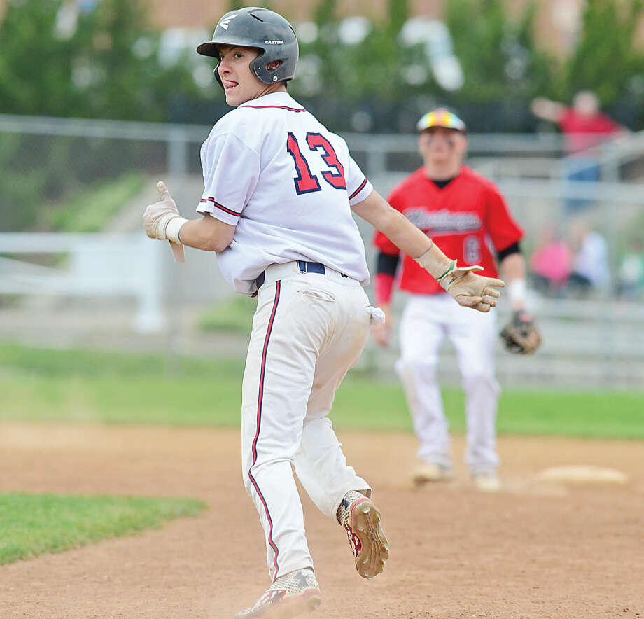 Hour photo / Erik Trautmann Brien McMahon High School's Hunter Dumas gets caught in between bases during their baseball game against Fairfield Warde Saturday in Norwalk.