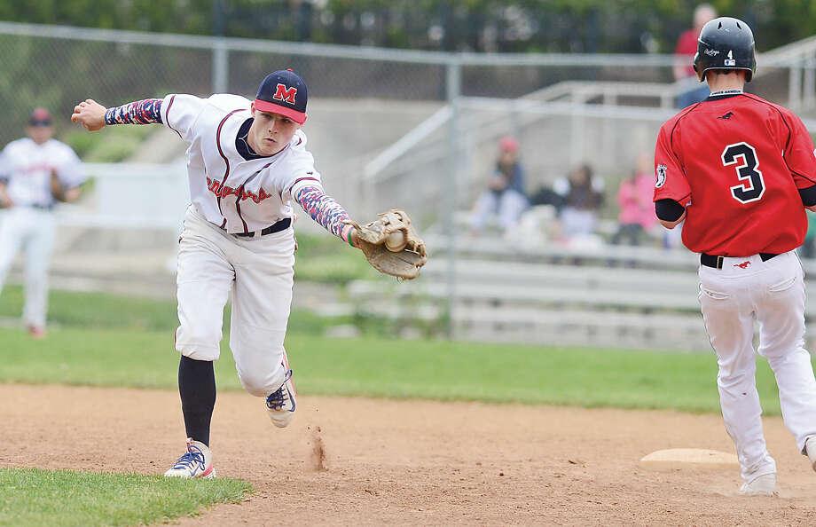 Hour photo / Erik Trautmann Brien McMahon High School's Chris Winthrop snags a wide throw during their baseball game against Fairfield Warde Saturday in Norwalk.