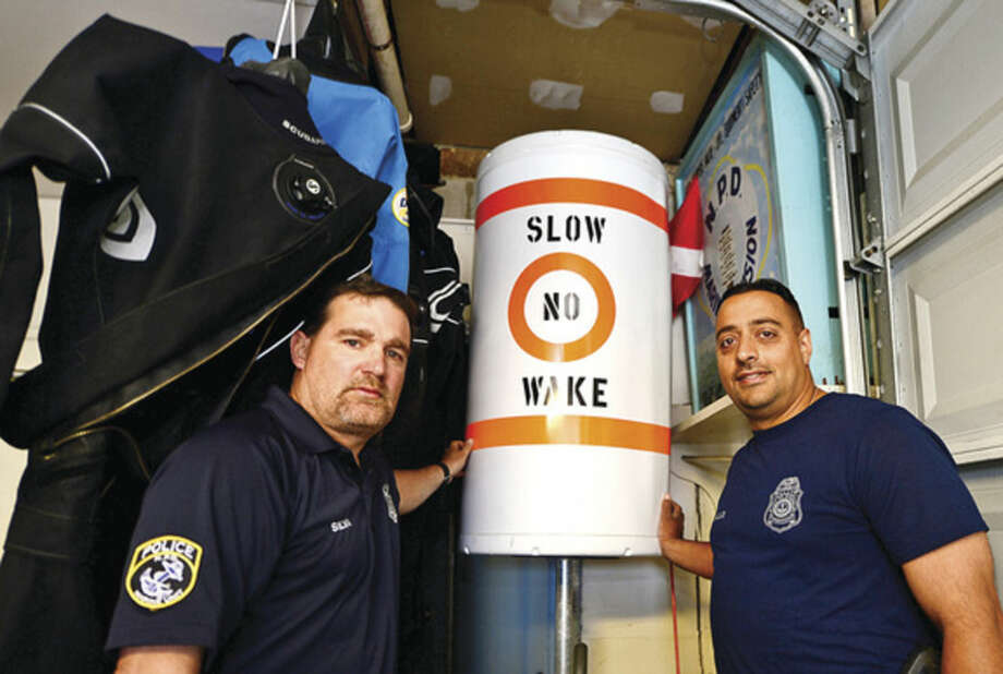Hour photo / Erik Trautmann Norwalk marine police officers Rich Dellalo and Mike Silva promote water sfaety as they patrol Norwalk Harbor and surrounding waters.