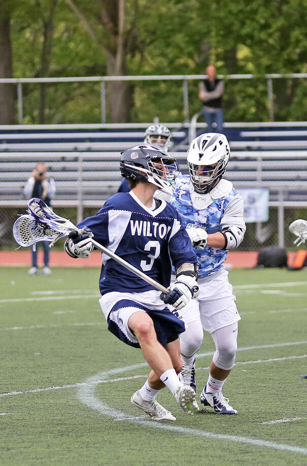 Wilton's #3, J. Maudsley, makes a pass during an away game against Wilton Saturday afternoon. Hour Photo / Danielle Calloway