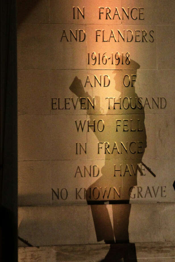 The shadow of an Australian soldier is cast on a monument for fallen soldiers during the wreath-laying ceremonies at the Australian National Memorial in Villers-Bretonneux, northern France, during Anzac Day, Friday, April 25, 2014. Anzac Day honors the men of the Australia-New Zealand Army Corps who died in World War I at the 1915 battle for Gallipoli, Turkey. It has since come to honor the sacrifices made by all service members in the Australian and New Zealand Armed Forces. (AP Photo/Michel Spingler)