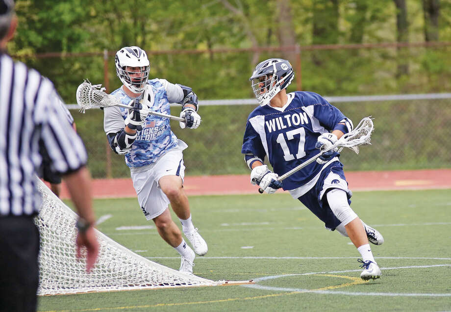 Wilton's #17, M. Lynch, runs with the ball during an away game against Wilton Saturday afternoon. Hour Photo / Danielle Calloway