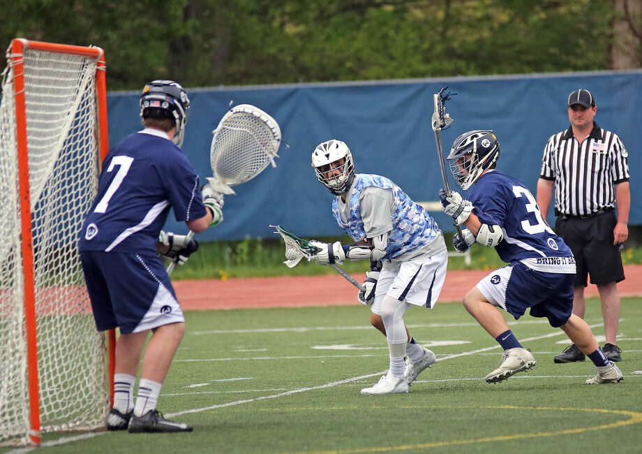 Staples #9, Peter Burger prepares to take a shot during a home game against Wilton Saturday afternoon. Hour Photo / Danielle Calloway