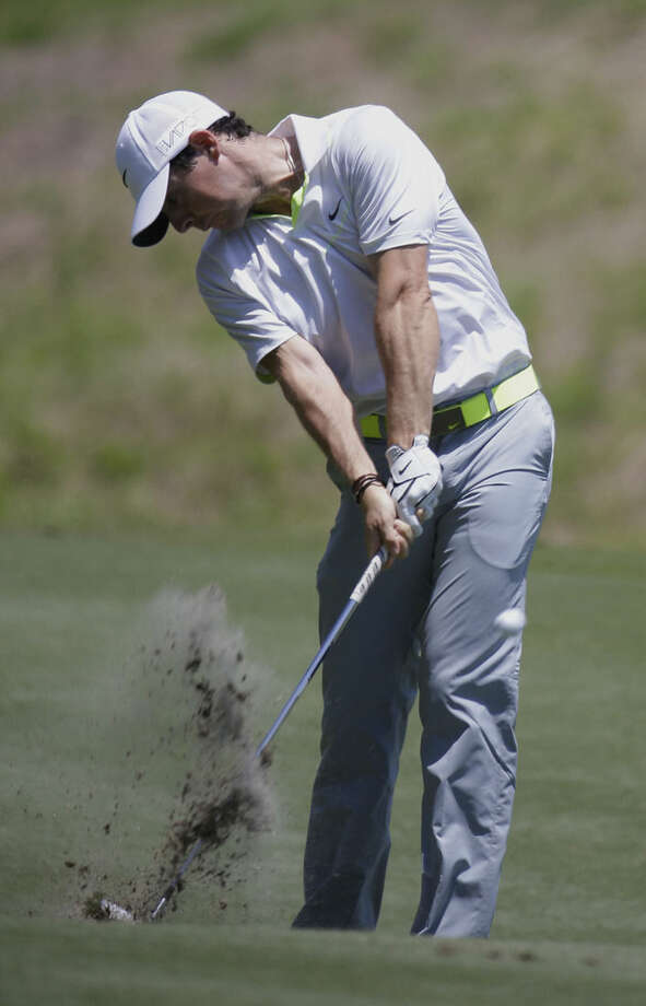 Rory McIlroy, of Northern Ireland, hits from the sixth fairway during the third round of The Players Championship golf tournament Saturday, May 9, 2015, in Ponte Vedra Beach, Fla. (AP Photo/Lynne Sladky)