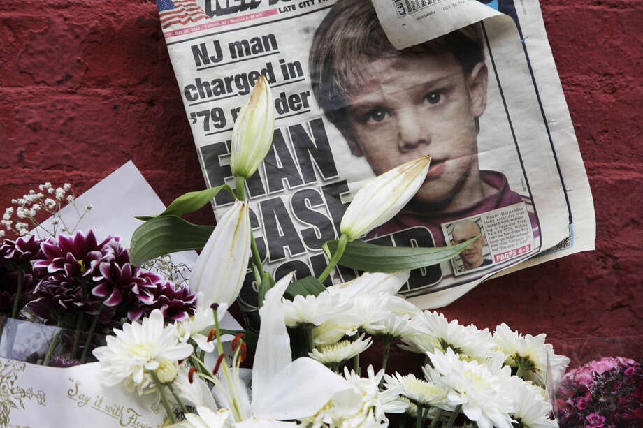 FILE - This May 28, 2012, file photo shows a newspaper with a photograph of Etan Patz at a makeshift memorial in the SoHo neighborhood of New York where Patz lived before his disappearance on May 25, 1979. The murder trial of Pedro Hernandez, the man accused in the child's disappearance, ended Friday, May 8, 2015 with the jury hopelessly deadlocked after 18 days of deliberations, leaving unresolved a case that has haunted New York City for 36 years. (AP Photo/Mark Lennihan, File)