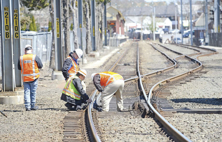 """Investigators look at a section of track in the New Canaan rail yard, south of the New Canaan train station. Service on Metro-North's New Canaan Branch was affected by a """"minor derailment"""" of a non-passenger trainon Thursday, April 14."""