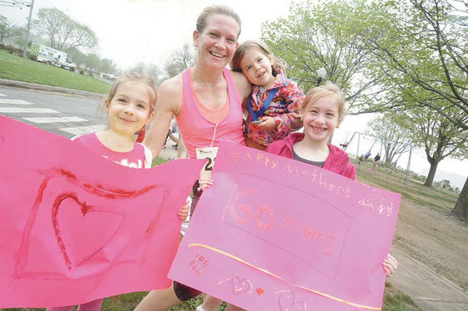 Mom Karen Kowalski greeted by her three daughters, Sophia 5, Emma, 8 and Olivia 8 after completing the Norwalk Mother's Day 10k race presented by the Lighfoot Running Club and the City of Norwalk Recreation and Parks Department on Sunday morning. Hour photo/Matthew Vinci