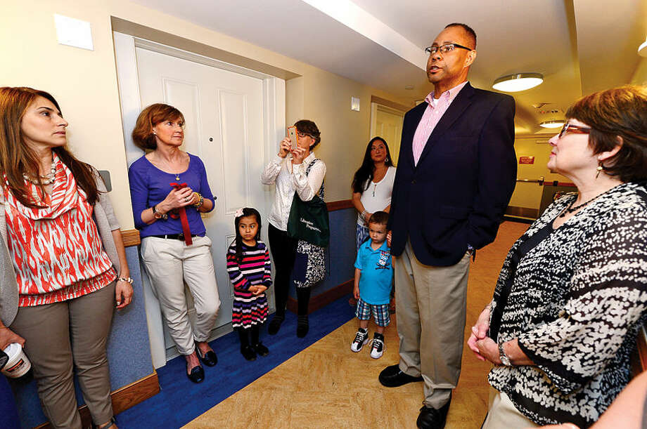Hour photo / Erik Trautmann Liberation House president and CEO Alan Mathis makes his remarks during the unveiling of the new Bright Space playroom Saturday for the Families In Recovery Program that was donated by Bright Horizons.