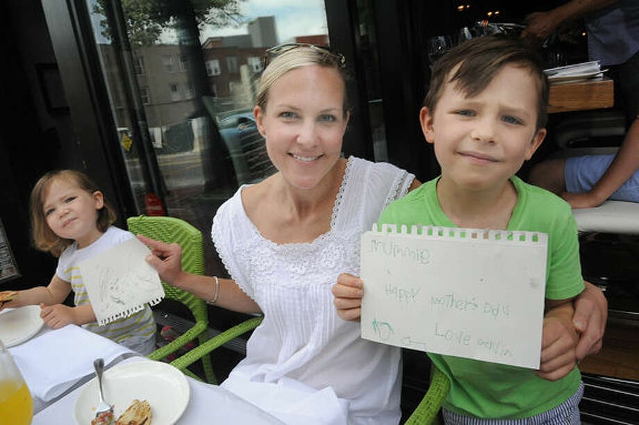 Mom Erica Spraker with her daughter Olivia 3 and son Gavin 5, with her handmade Mother's Day cards enjoy brunch at Match in South Norwalk. Hour photo/Matthew Vinci