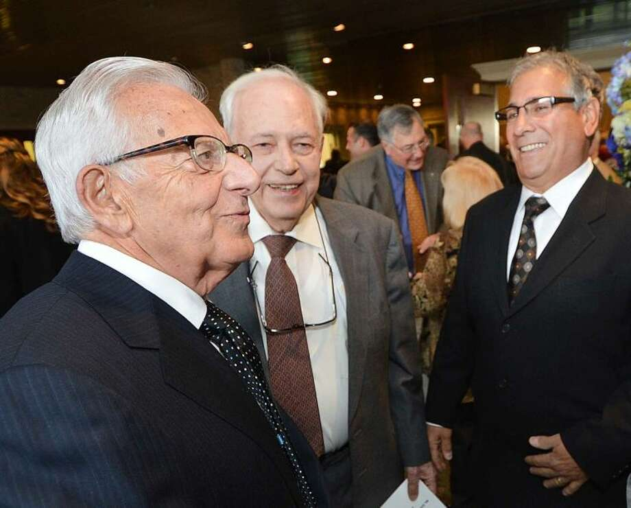 Hour Photo/Alex von Kleydorff Man of the year honorees Sam and Rocky Cingari talk with friends during the Cocktail Reception at The Stamford Chapter of UNICO, Giuseppe Garibaldi Award Dinner Dance.