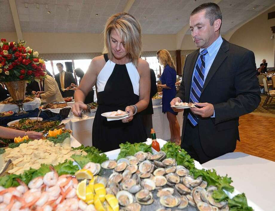 Hour Photo/Alex von Kleydorff Jenny and Jim Metheny enjoys some seafood appetizers during the reception at The Stamford Chapter of UNICO, Giuseppe Garibaldi Award Dinner Dance.