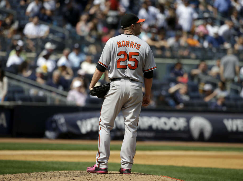 Baltimore Orioles starting pitcher Bud Norris reacts after giving up four runs during the fourth inning of the baseball game against the New York Yankees at Yankee Stadium, Sunday, May 10, 2015 in New York. (AP Photo/Seth Wenig)