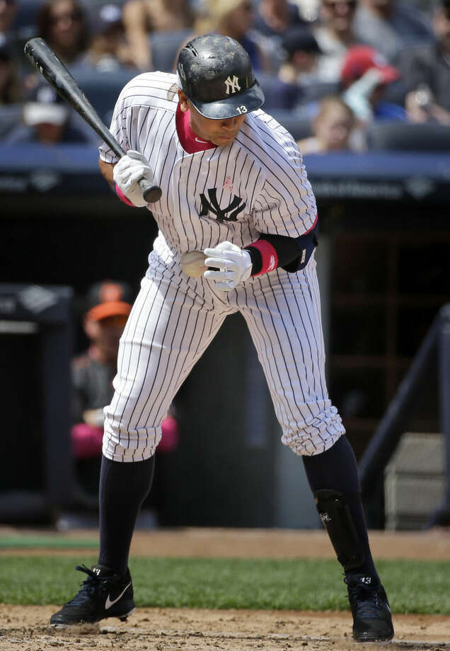 New York Yankees' Alex Rodriguez is hit by a pitch during the third inning of the baseball game against the Baltimore Orioles at Yankee Stadium, Sunday, May 10, 2015 in New York. (AP Photo/Seth Wenig)