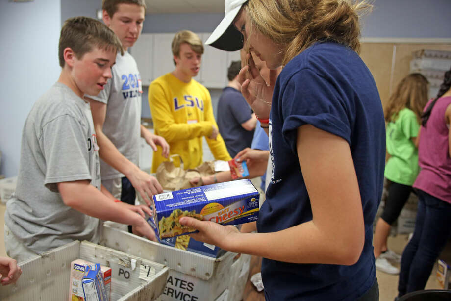 Food is sorted from the Person to Person truck at the South Norwalk Community Center for the National Association of Letter Carriers Food Drive Saturday afternoon. Hour Photo / Danielle Calloway