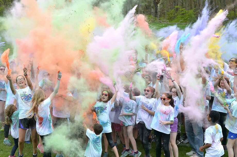 "Wilton Youth Council's Youth to Youth club's new fundraising event called ""My School Color Run,"" at Middlebrook School in Wilton, where participants walk/run a set course and get doused with spray color from Middlebrook staff during their run on Thursday May 5 2016 in Wilton Conn."