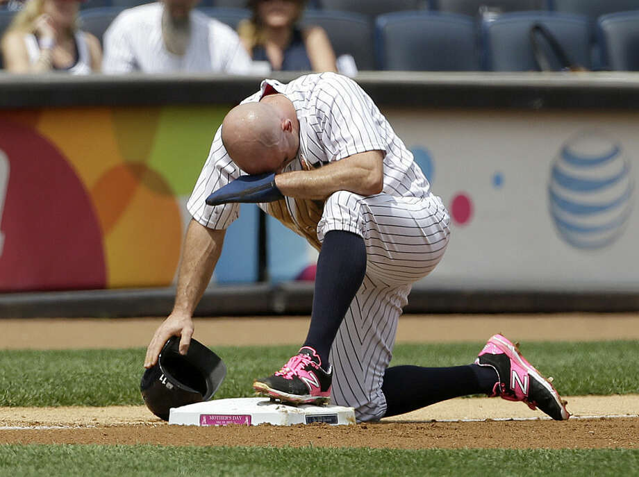 New York Yankees' Brett Gardner reacts after failing to steal third base during the first inning of the baseball game against the Baltimore Orioles at Yankee Stadium, Sunday, May 10, 2015 in New York. (AP Photo/Seth Wenig)