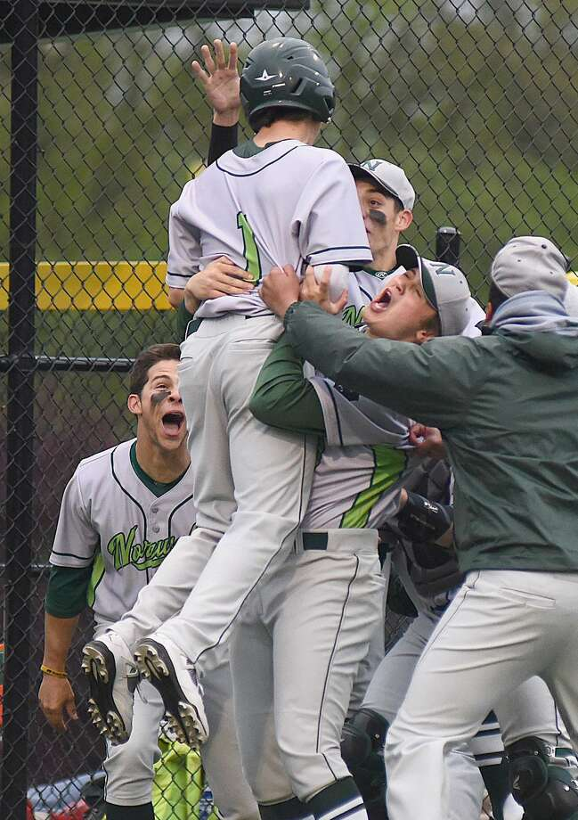 Norwalk's Tommy Benincaso, left, gets hoisted in the air by teammates after hitting a two-run home run in the fourth inning of Thursday's game against cross-city rival Brien McMahon. The host Bears walked off with a 6-5 win in the bottom of the seventh.