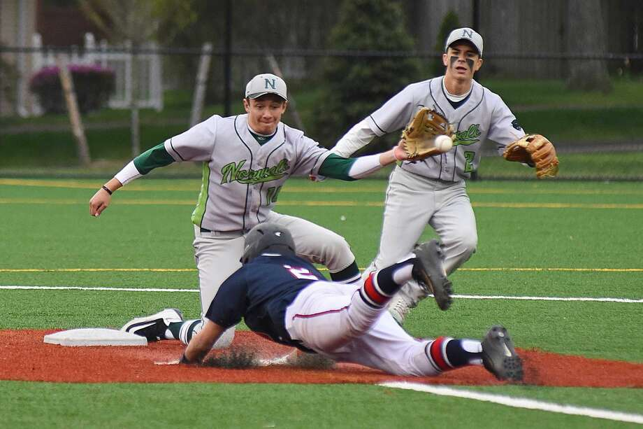 Norwalk shortstop Eddie McCabe, left, tries to grab a throw on a stolen base attempt by Brien McMahon's Anthony Socci as Bears second baseman Kyle Mossop backs up the play at Nathan Hale Middle School in Norwalk on Thursday. Norwalk won the game 6-5.