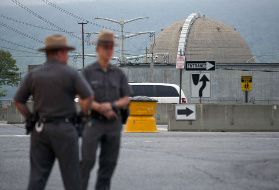 New York State Troopers stand at the main entrance of the Indian Point nuclear power plant Saturday May 9, 2015, after a transformer failed at New York's Indian Point 3 nuclear power plant, causing a fire that has been extinguished in Buchanan, N.Y. A spokesman for Entergy says the unit has shut down automatically and is safe and stable. (AP Photo/Craig Ruttle)