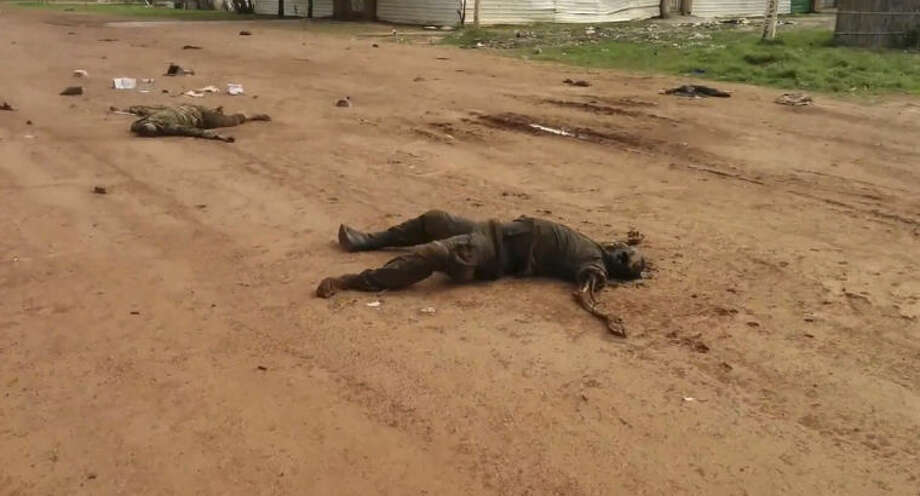 """EDS NOTE GRAPHIC CONTENT In this image taken from video dead bodies lie on the road near Bentiu South Sudan on Sunday April 20, 2014. U.N.'s top humanitarian official in South Sudan Toby Lanzer told The Associated Press in a phone interview Tuesday April 23, 2014, that the ethnically targeted killings are """"quite possibly a game-changer"""" for a conflict that has been raging since mid-December and that has exposed longstanding ethnic hostilities. There was also a disturbing echo of Rwanda, which is marking the 20th anniversary this month of its genocide that killed 1 million people. """"It's the first time we're aware of that a local radio station was broadcasting hate messages encouraging people to engage in atrocities,"""" said Lanzer, who was in Bentiu on Sunday and Monday. """"And that really accelerates South Sudan's descent into an even more difficult situation from which it needs to extract itself."""" (AP Photo/Toby Lanzer, United Nations)"""