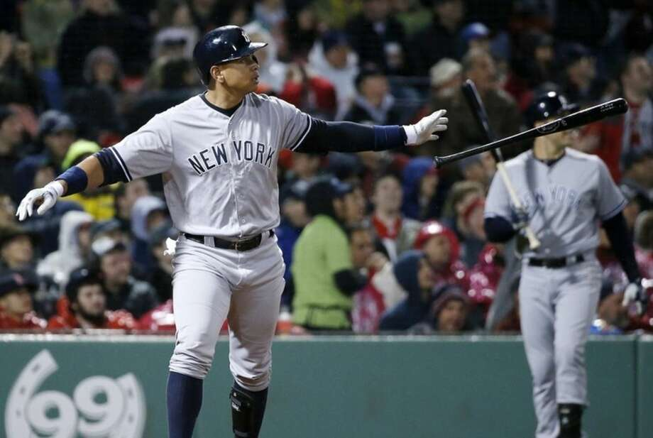 New York Yankees' Alex Rodriguez watches his two-run double during the fifth inning of a baseball game against the Boston Red Sox in Boston, Sunday, May 1, 2016. (AP Photo/Michael Dwyer)