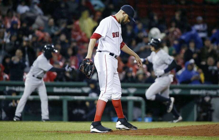 Boston Red Sox's David Price kicks the mound as New York Yankees' Alex Rodriguez, right, rounds third base on his two-run home run during the third inning of a baseball game in Boston, Sunday, May 1, 2016. (AP Photo/Michael Dwyer)