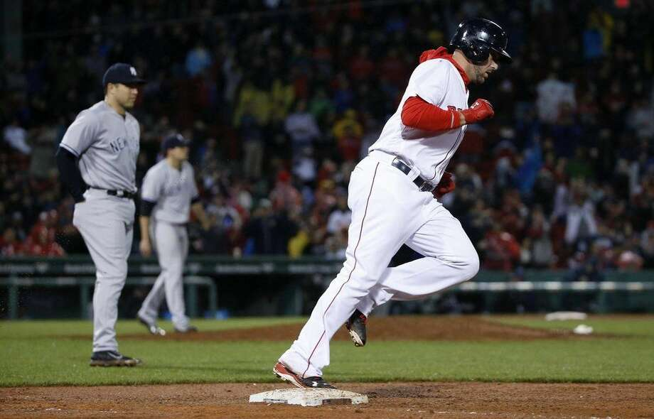 Boston Red Sox's Travis Shaw rounds first base on his two-run home run during the fifth inning of a baseball game against the New York Yankees in Boston, Sunday, May 1, 2016. (AP Photo/Michael Dwyer)