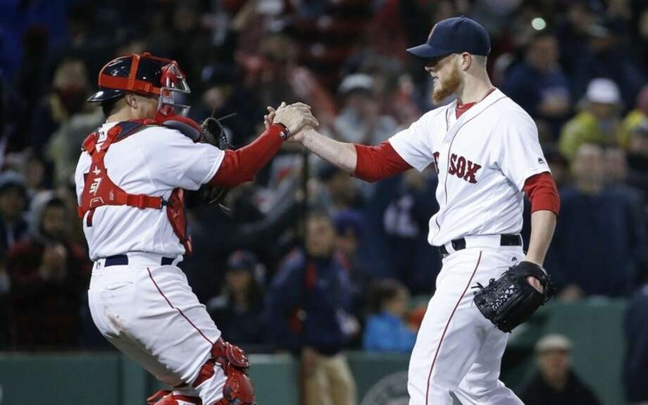 Boston Red Sox's Craig Kimbrel, right, and Christian Vazquez celebrate after the Red Sox defeated the New York Yankees 8-7 during a baseball game in Boston, Sunday, May 1, 2016. (AP Photo/Michael Dwyer)