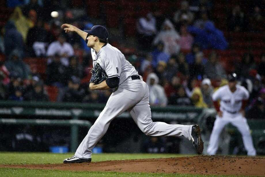 New York Yankees' Nathan Eovaldi pitches during the first inning of a baseball game against the Boston Red Sox in Boston, Sunday, May 1, 2016. (AP Photo/Michael Dwyer)