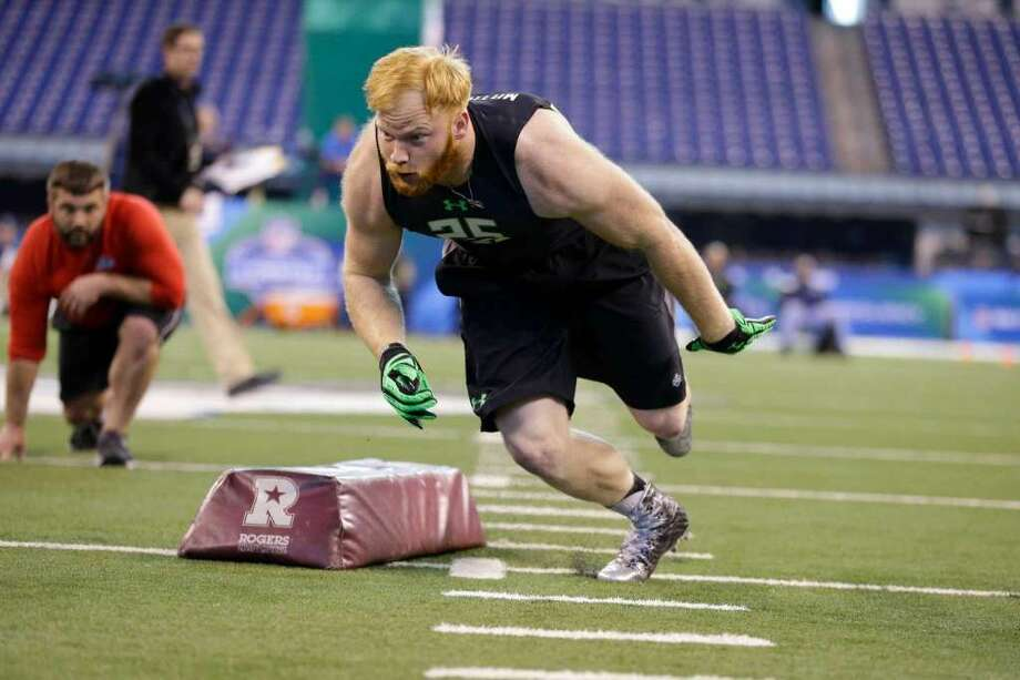 Temple linebacker Tyler Matakevich runs a drill at the NFL football scouting combine in Indianapolis, Sunday, Feb. 28, 2016. (AP Photo/Michael Conroy)