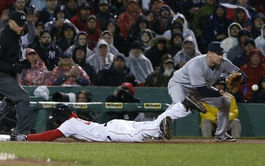 Boston Red Sox's Mookie Betts slides safely into third base as New York Yankees' Chase Headley, right, gets the throw on a single by Dustin Pedroia during the first inning of a baseball game in Boston, Sunday, May 1, 2016. (AP Photo/Michael Dwyer)