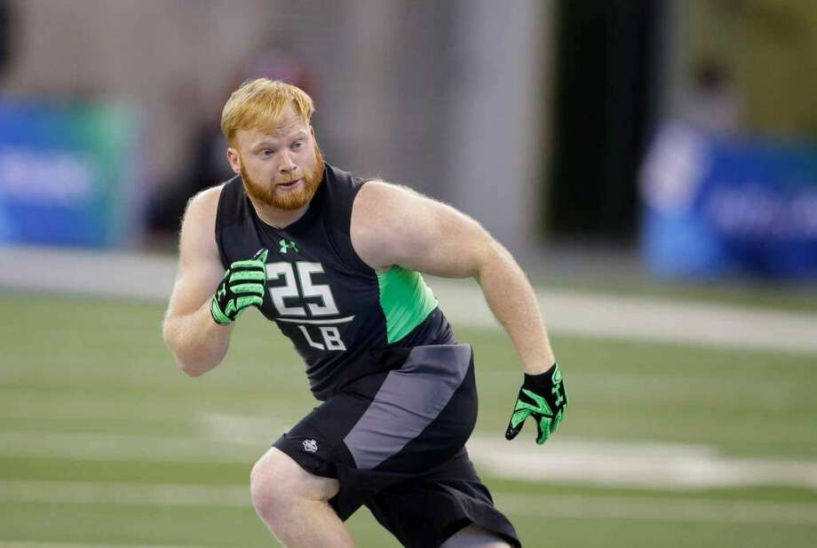 Temple linebacker Tyler Matakevich runs a drill at the NFL football scouting combine on Sunday, Feb. 28, 2016, in Indianapolis. (AP Photo/Darron Cummings)