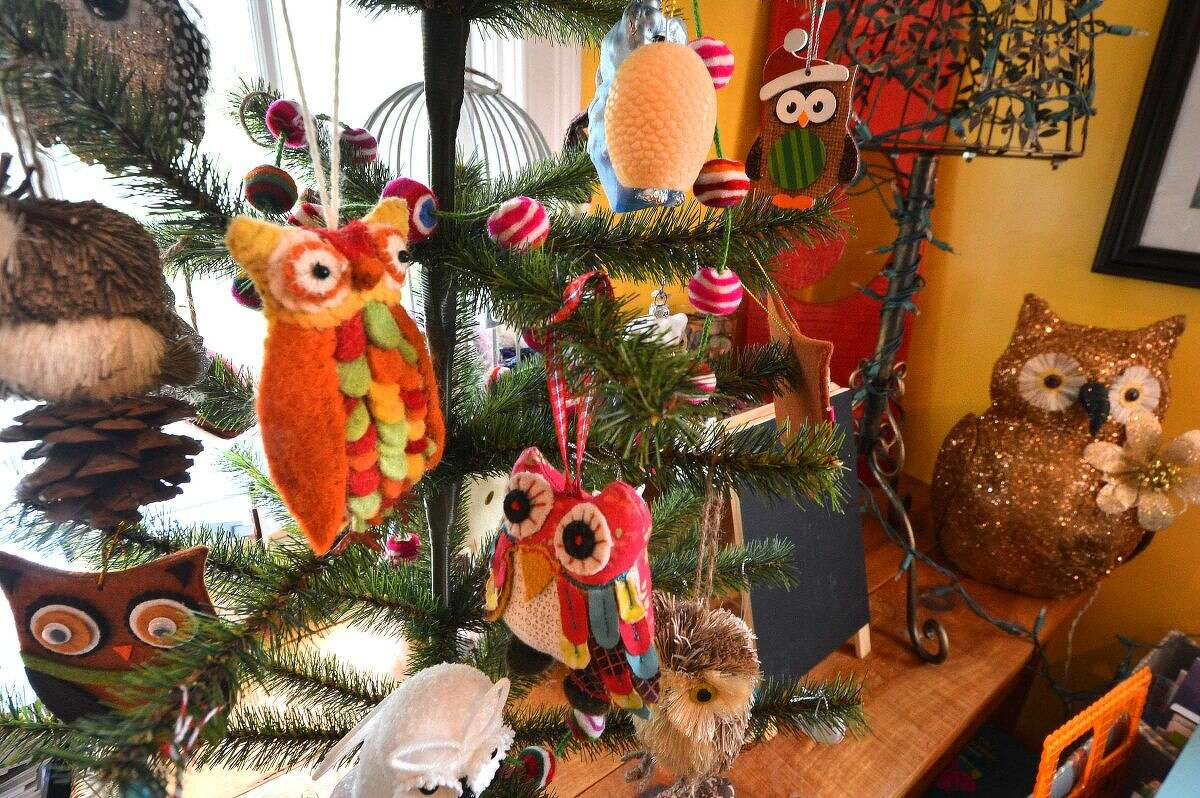Toy Owls hang from a small plastic tree in the Wilton offices of Brain, Child Magazine.
