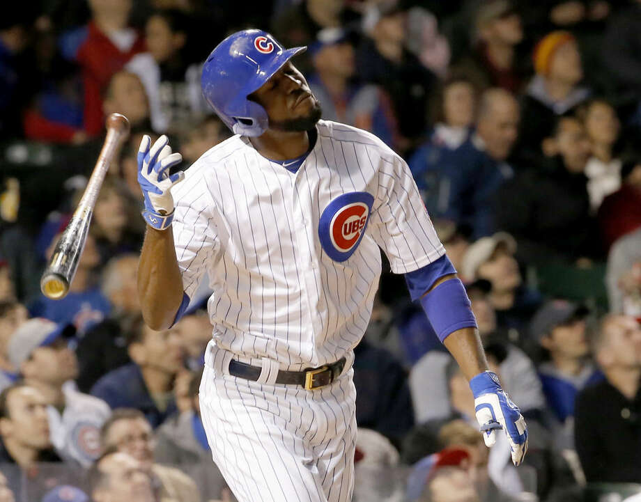 Chicago Cubs' Dexter Fowler flips his bat after popping up on a pitch from New York Mets starter Noah Syndergaard during the fifth inning of a baseball game Tuesday, May 12, 2015, in Chicago. (AP Photo/Charles Rex Arbogast)