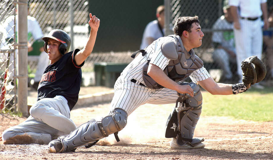 Norwalk catcher Marco Monteiro receives a late throw from the outfielder as Stamford's Billy Devito scores during Monday's FCIAC baseball game at Malmquist Field in Norwalk. The Bears walked off with an 11-10 come-from-behind win over the Black Knights. (Hour photo/John Nash)