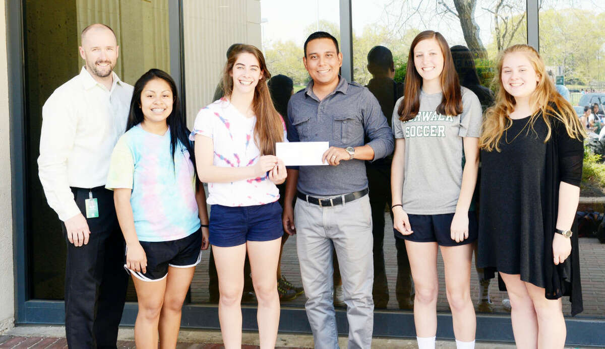 Contributed photo Norwalk High School's National Honor Society members present a check for $2,500 to the Norwalk/Nagarote Sister City Project to provide scholarships for students in Nicaragua. From Left, Norwalk High English teacher Kurt Simonsen, Fairi Galicia, Margo Libre, Norwalk/Nagarote Sister City Project Field Director Miguel Salinas, Kasey Hogan, and Emma Cooney.