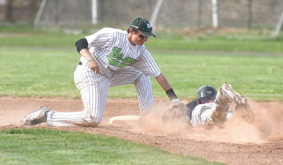 Norwalk shortstop Eddie McCabe tags out Stamford's Justin Mason, trying to steal second base. (Hour photo/John Nash)