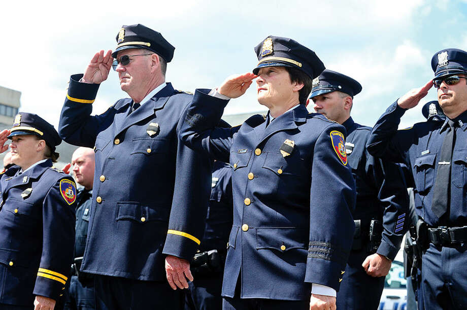 Hour photo / Erik Trautmann High ranking officers salute as The Stamford Police Department holds their annual memorial service Wednesday morning to honor those officers who died in the line of duty.