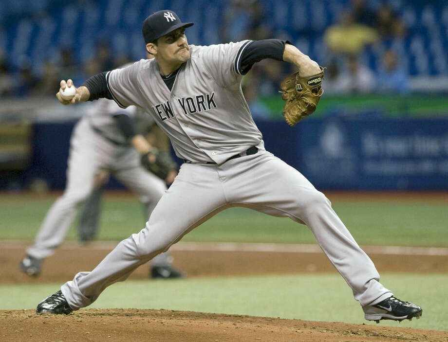 New York Yankees starter Nathan Eovaldi pitches against the Tampa Bay Rays during the first inning of a baseball game Tuesday, May 12, 2015, in St. Petersburg, Fla. (AP Photo/Steve Nesius)
