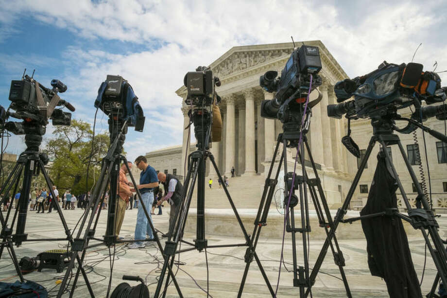 AP photoVideojournalists set up outside of the Supreme Court in Washington on Tuesday. The court is hearing arguments between Aereo, Inc., an internet startup company that gives subscribers access to broadcast television on their laptops and other portable devices and the broadcasters.
