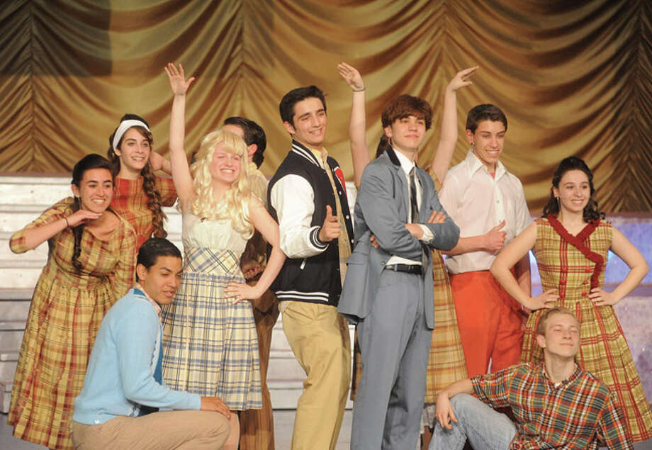 """Some of the many cast members of """" Hairspray"""" in a dress rehearsal Tuesday at Norwalk High School. Hour photo/Matthew Vinci"""
