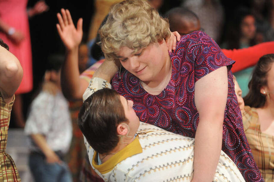 "Max Helfand as Edna and Chris Faccenda as Wilbur Tuesday night in a dress rehearsal for ""Hairspray"" at Norwalk High School. Hour photo/Matthew Vinci"