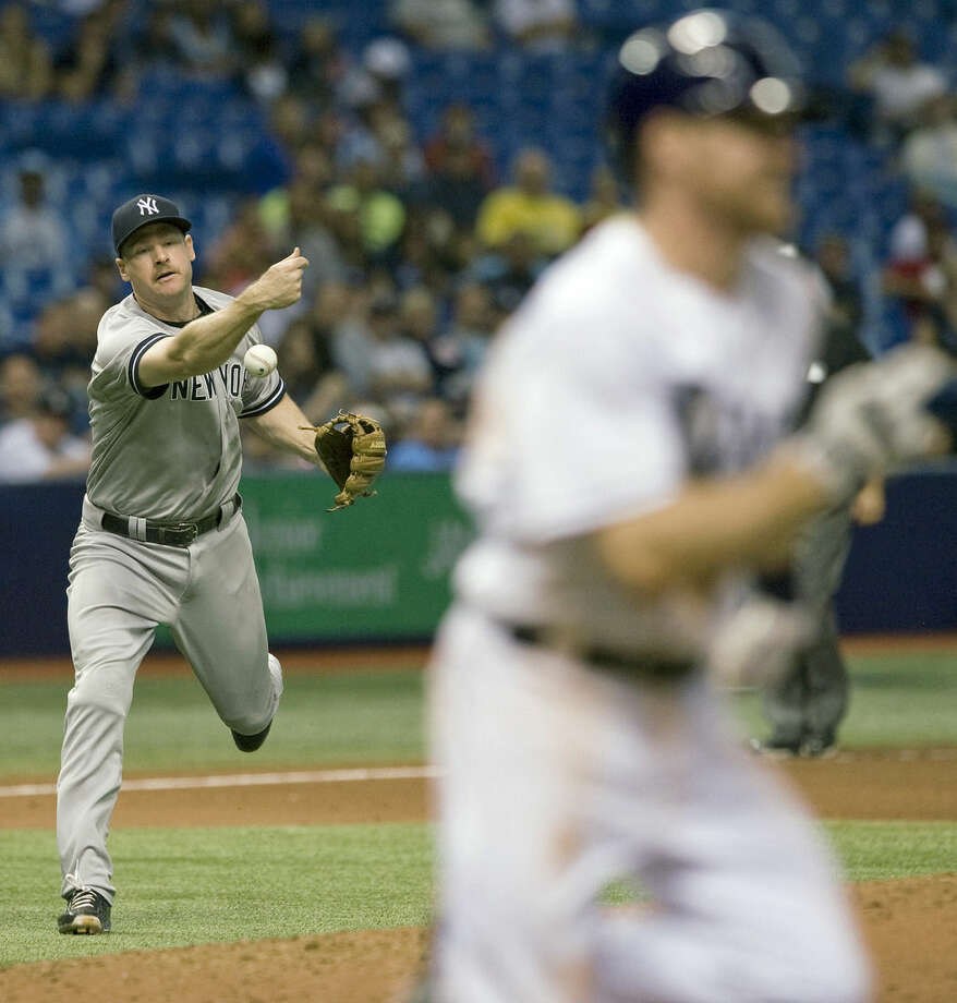Tampa Bay Rays' Logan Forsythe, right, runs to first base on an infield single to New York Yankees third baseman Chase Headley, left, during the fifth inning of a baseball game Tuesday, May 12, 2015, in St. Petersburg, Fla. (AP Photo/Steve Nesius)
