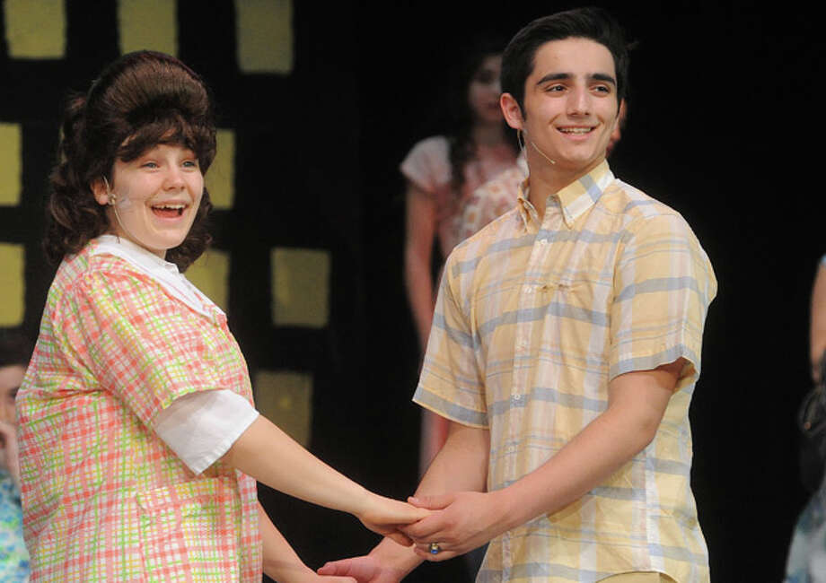 "Krystina Lyons as Tracy Turnblad and Sam Patterson as Link Larkin in a dress rehearsal for ""Hairspray"" at Norwalk High School. Hour photo/Matthew Vinci"